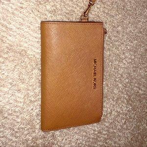 KORS wristlet/phone wallet luggage & goldtone.EUC